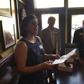 Pam Danbusky reading a letter from Janel Jorgensen McArdle