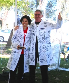 Julie Saba and Rob Goldsby lab coats